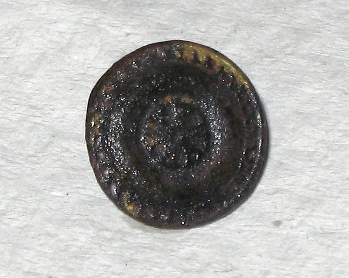 En af knapperne fra graven